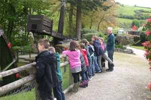 school group looking at the waterwheel
