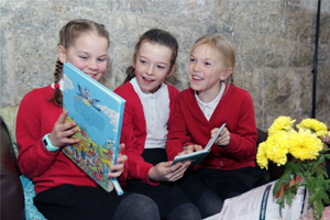 children reading at Wheal Martyn