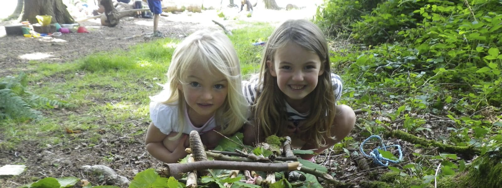 children exploring the woodlands