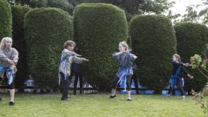 children dancing in the woodlands